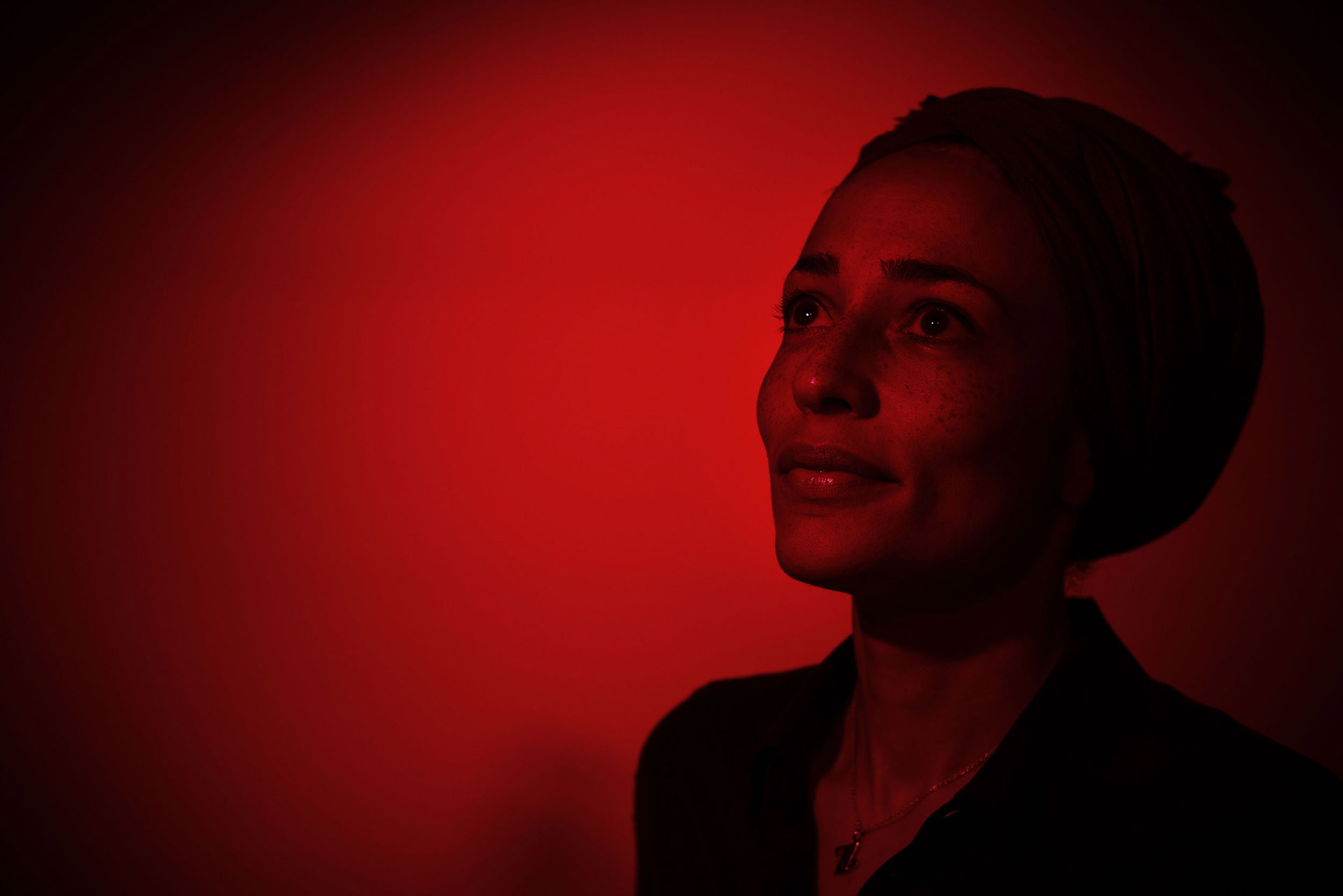 Portraiture Manchester Photographer - Artists & Actors.  Photograph with red lighting of Writer Zadie Smith at Manchester Literary Festival photographer manchesterphotographer.com
