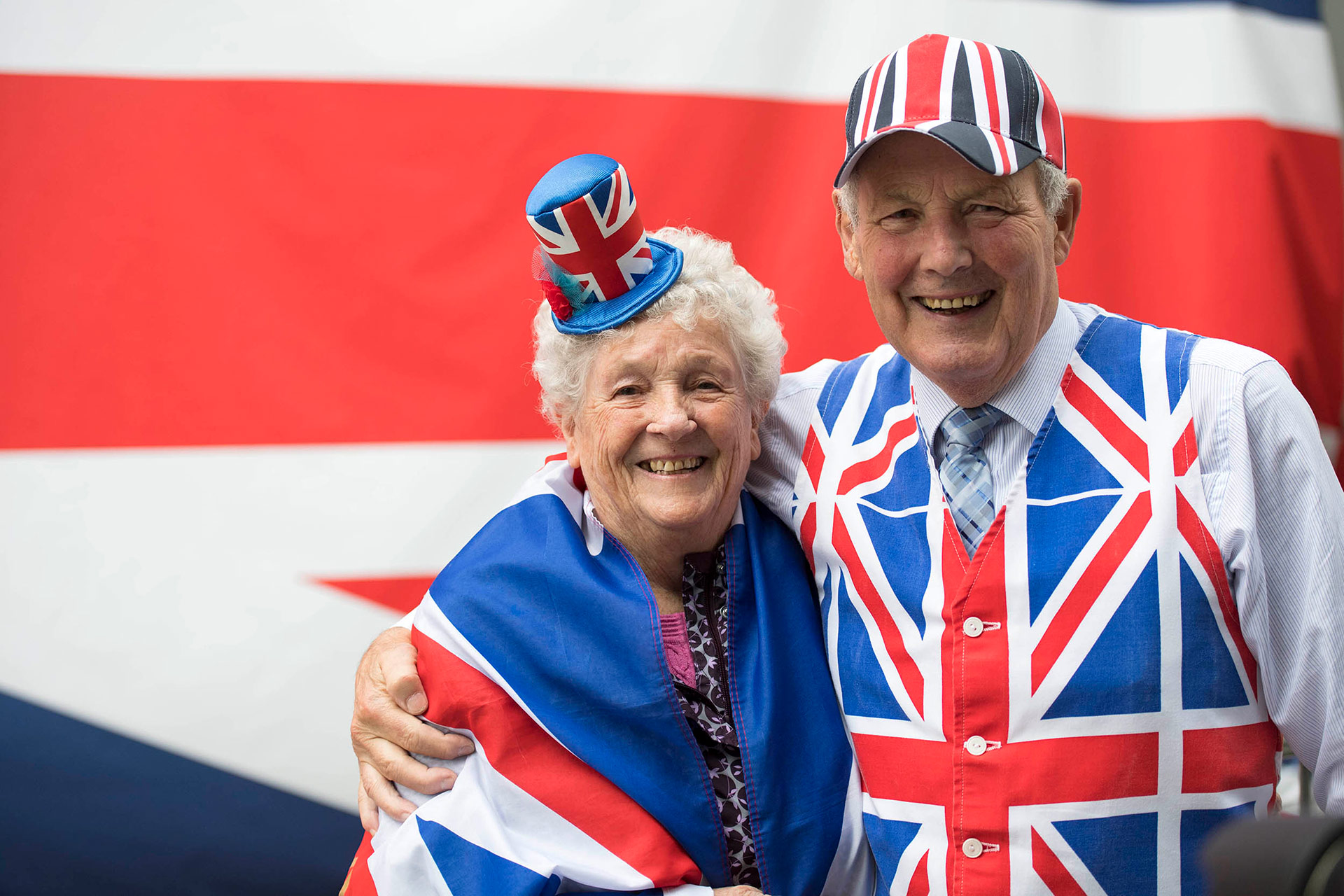 Two pensioners are photographed in union jack clothing during an Olympic parade Manchester. Olympic photography by Manchester Photographer