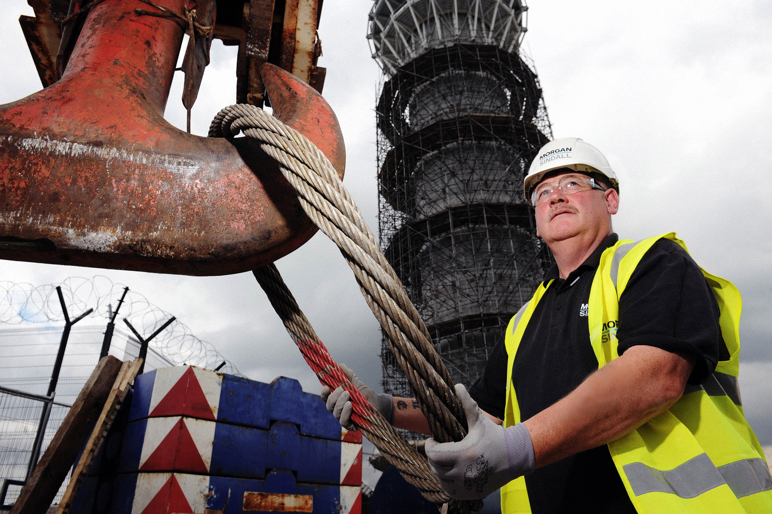 A construction worker helps build Manchester Airport's aircraft control tower.