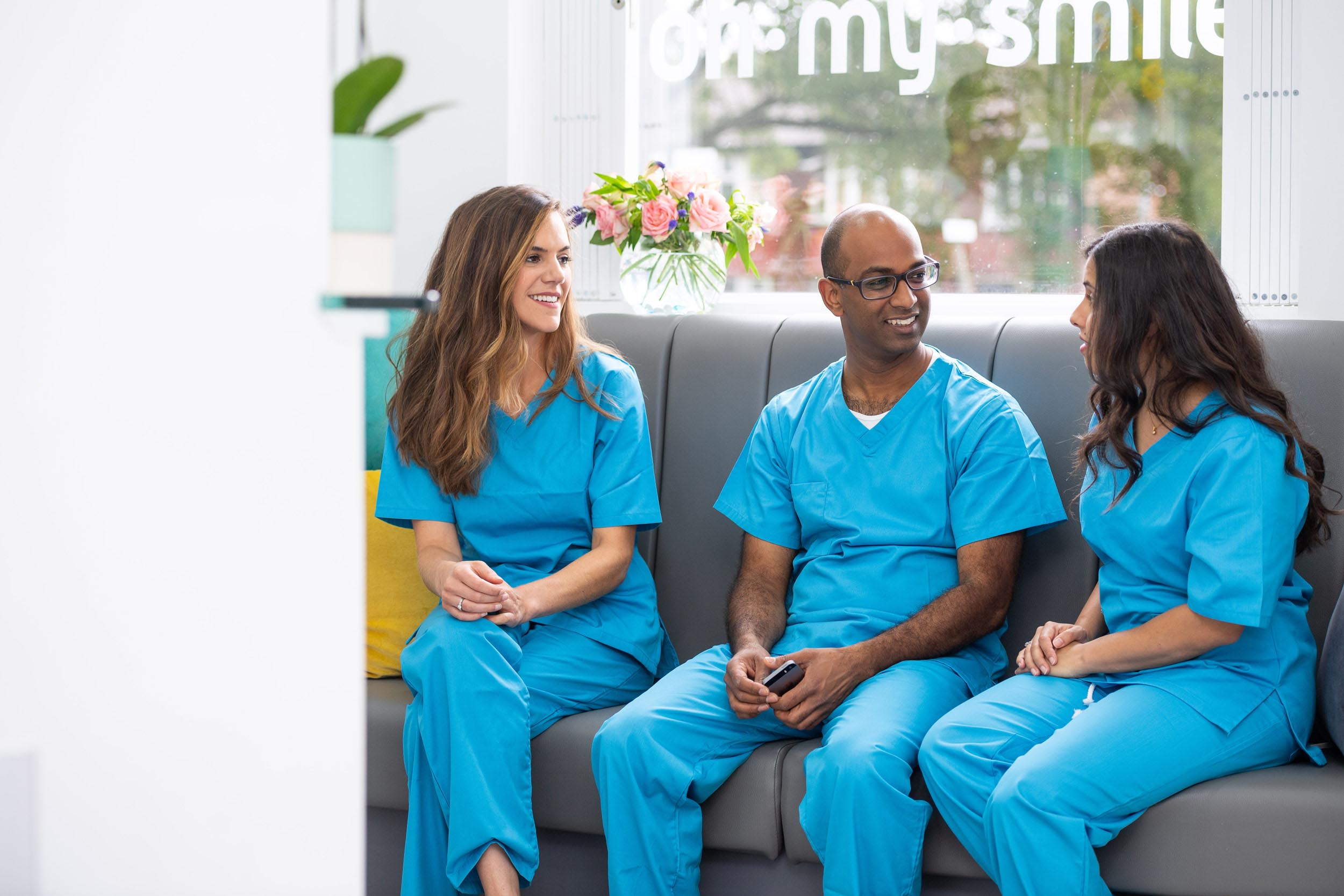 Dentists hold an impromptu meeting in a waiting room