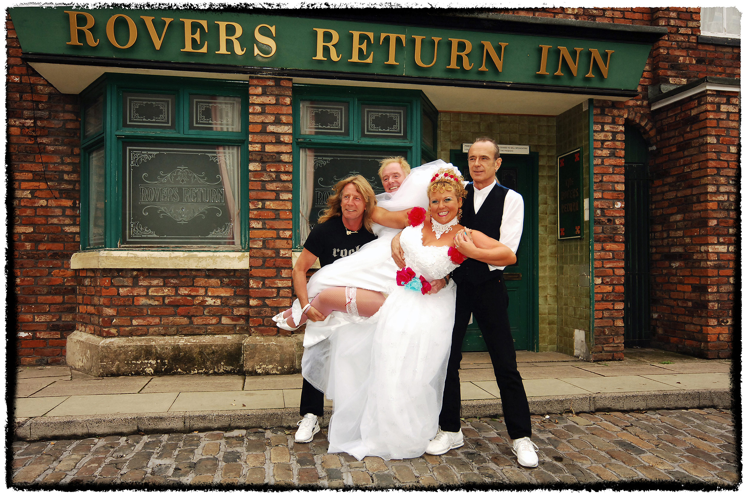 Rock and soap stars meet for a photograph on the cobbled street of ITV's long running soap opera, Coronation St