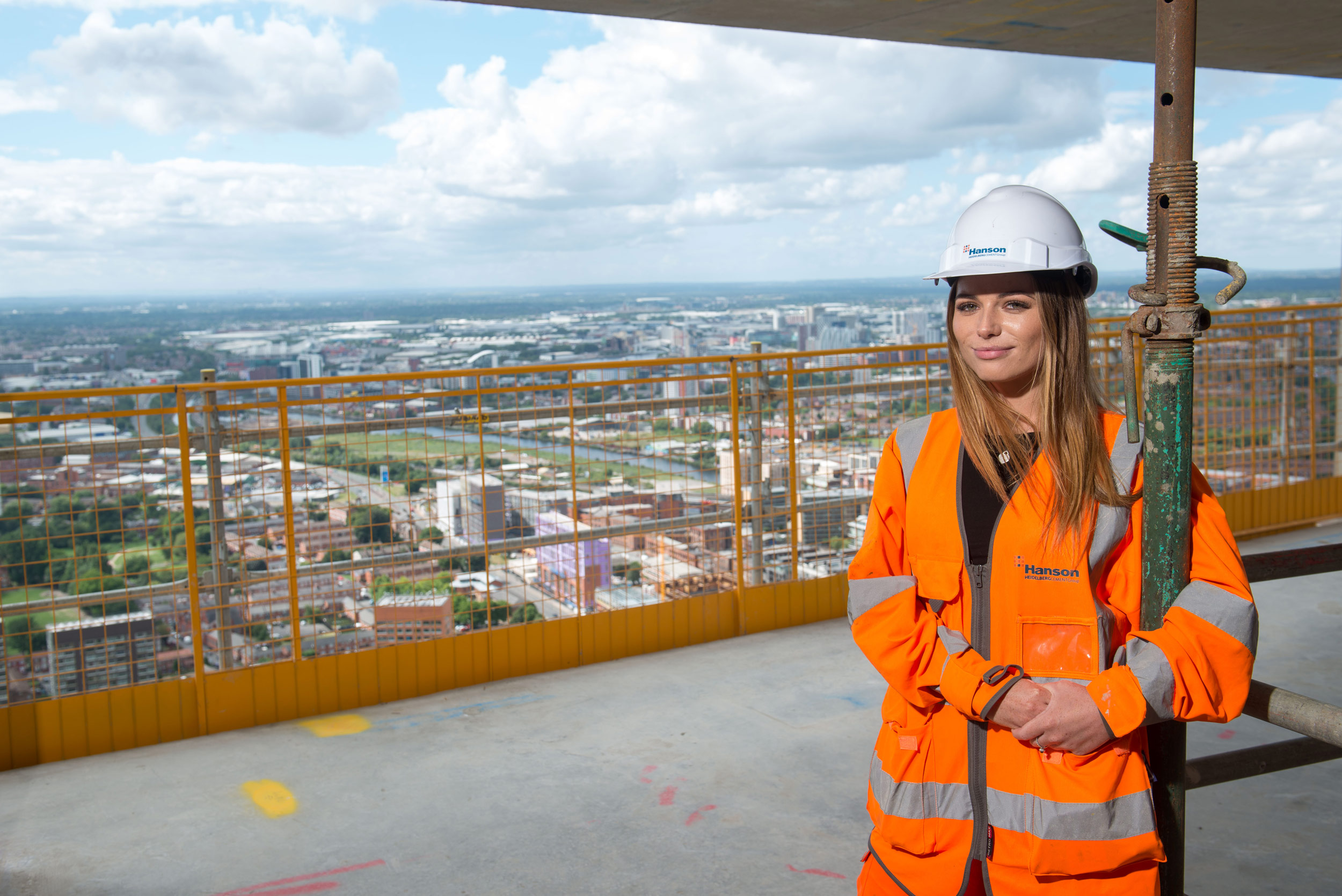a female graduate working on a new city centre skyscraper in Manchester