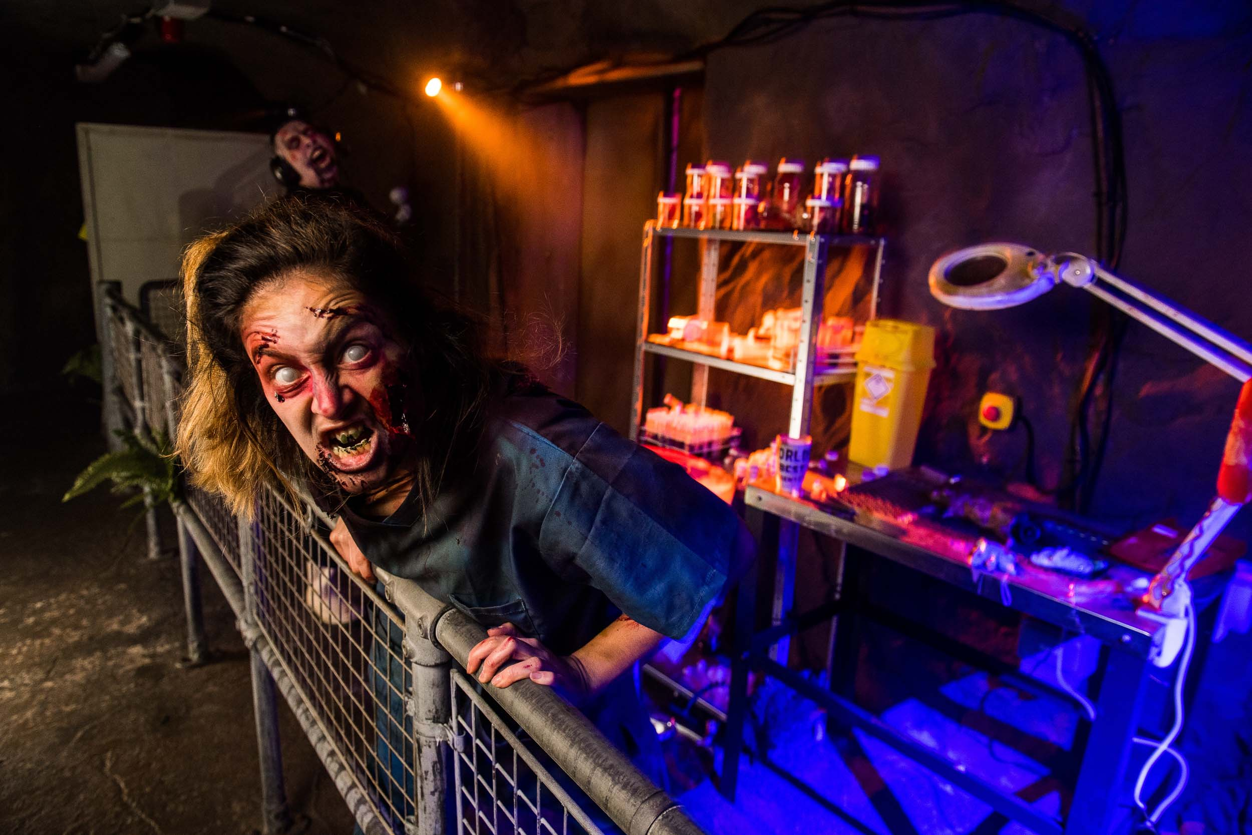 A zombie scares visitors to a theme park in England. Photographs of Scarefest at Alton Towers