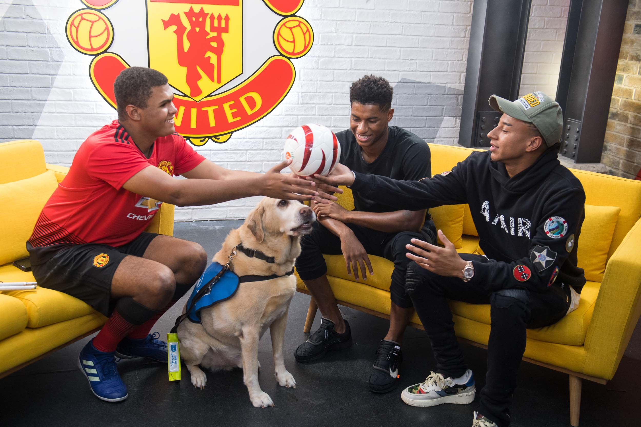Two professional Manchester united football players meet an amateur player who plays blind football.