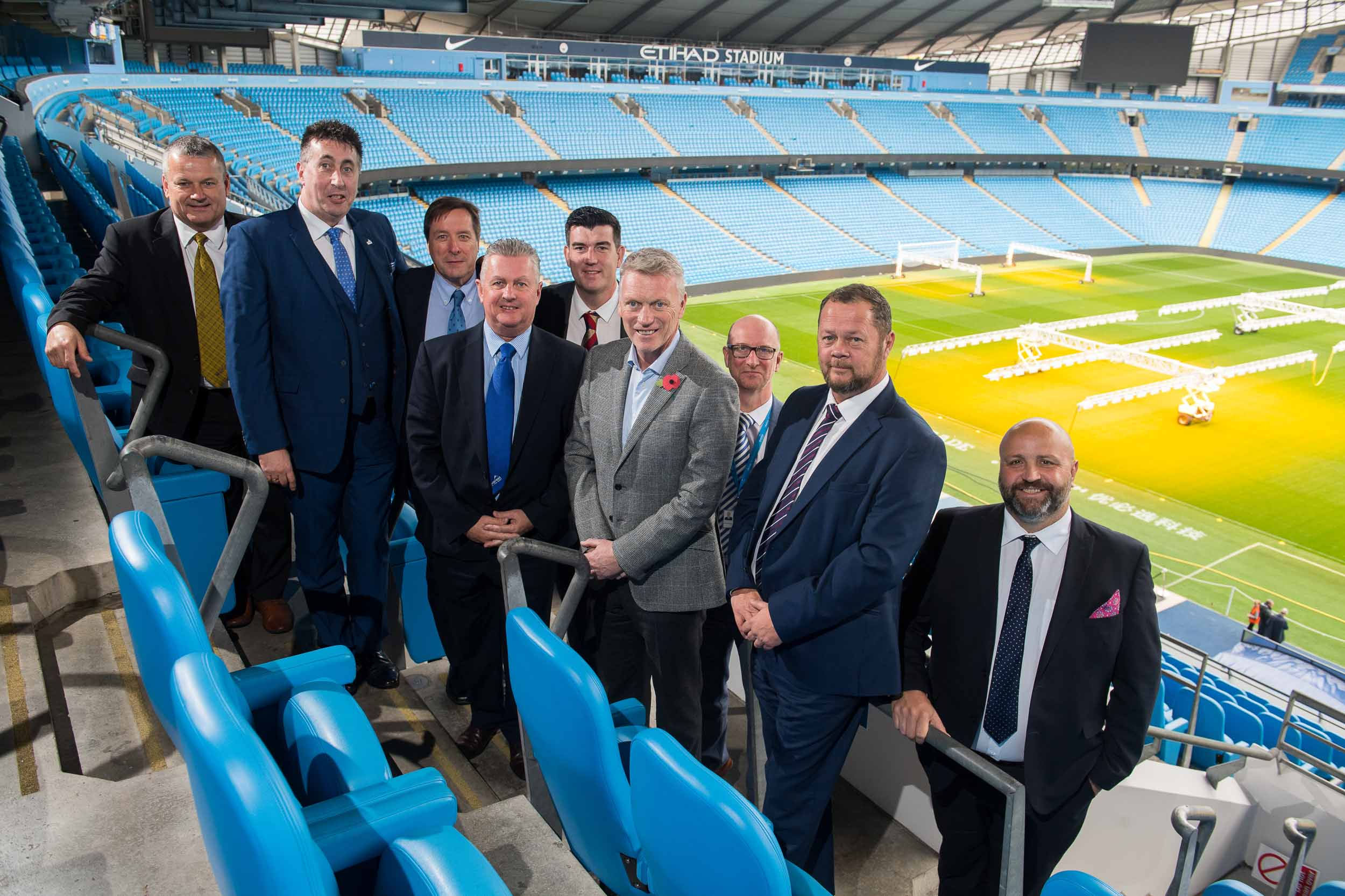 Football manager meets business leaders at football stadium. Moyes makes return to Manchester City.