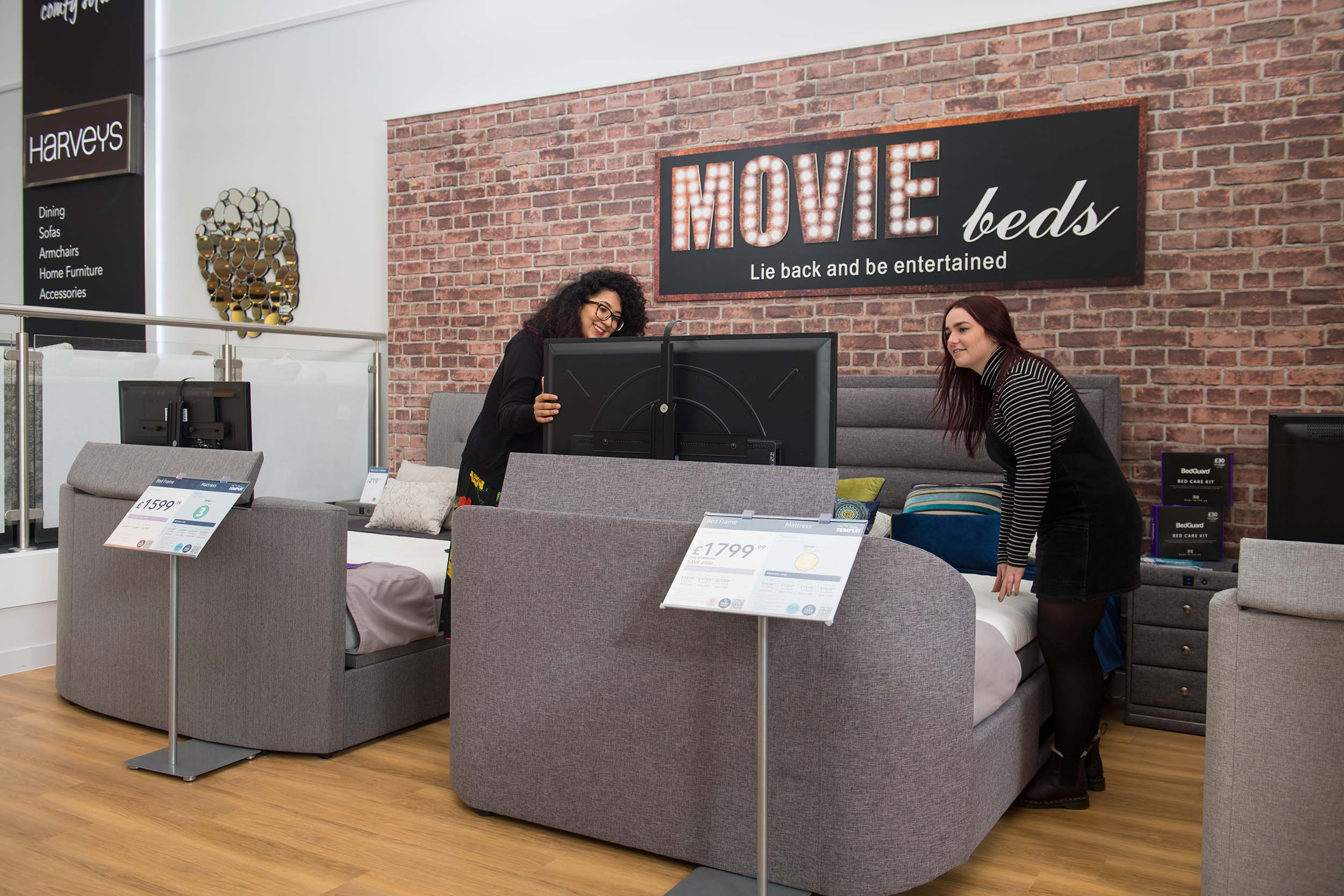 Customers looking at Movie Beds in Harveys Furniture