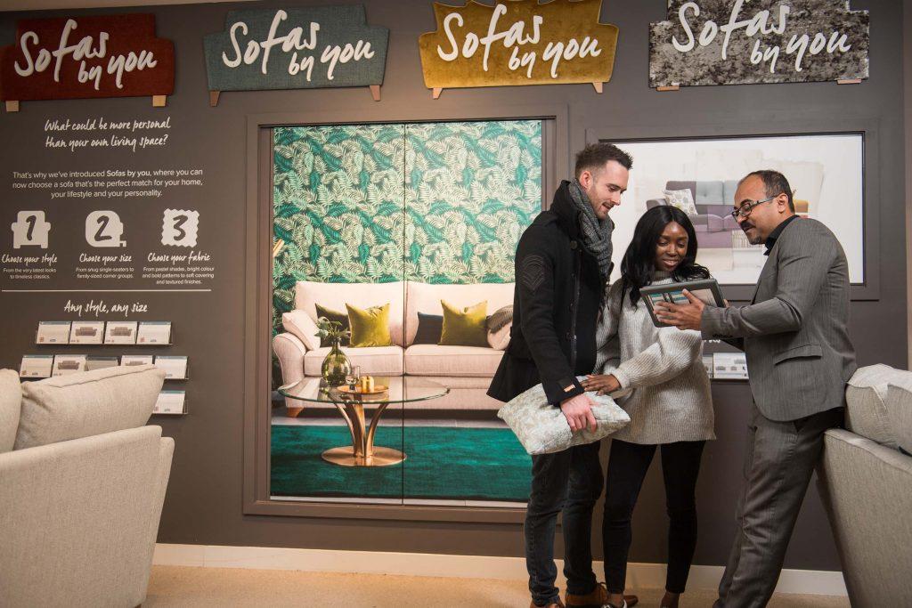 Couple with Salesman at Harveys Furniture